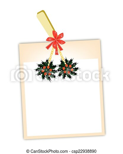 Blank Photos with Christmas Holly Hanging on Clothesline - csp22938890