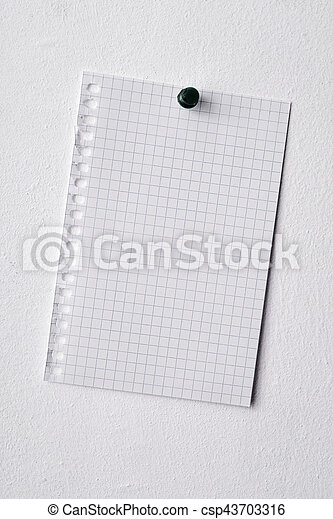 blank piece of paper pinned in a wall closeup of a blank piece of