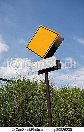 Blank road warning sign against blue sky - csp30826230