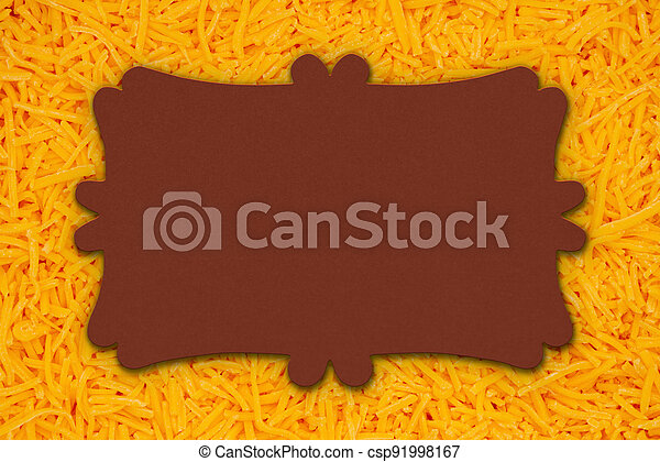 Blank sign on shredded cheddar cheese in pile background - csp91998167