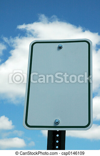Blank Traffic Sign against a Blue Sky and Clouds - csp0146109