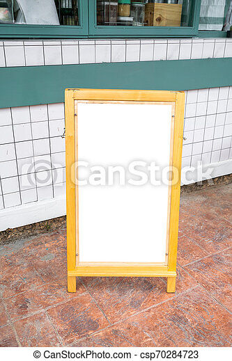 Blank white menu stand on floor in front of restaurant - csp70284723