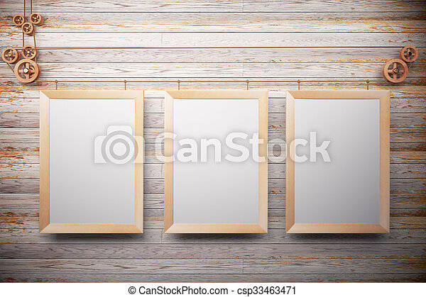 Blank wooden picture frames on wooden wall, mock up - csp33463471