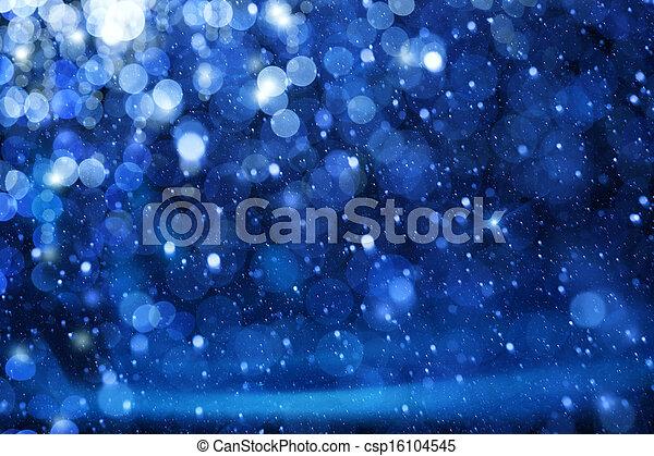 Kunst-Weihnachtslichter auf blauem Hintergrund - csp16104545