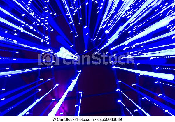 Lichtgeschwindigkeit - blaue Spuren von Lichtpunkten im Raum. - csp50033639