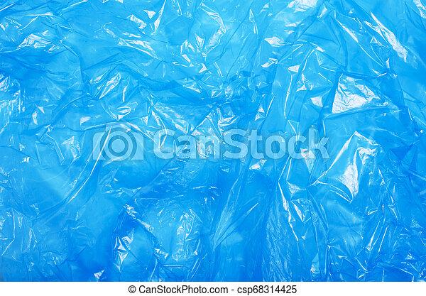 Blauer Plastikbeutel, krumme Zellophan-Struktur Hintergrund - csp68314425