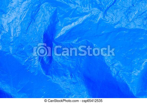 Abstract Hintergrund-Crumpled Plastik Film Textur blauer Müllbeutel - csp65412535