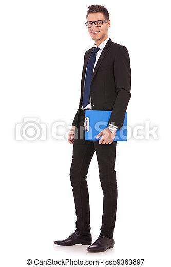 blauwe , klembord, jonge, zakenmens  - csp9363897