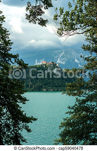 Bled castle between trees over the lake - csp59040478