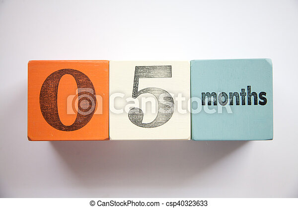 Block numbers and letters 5 months - csp40323633