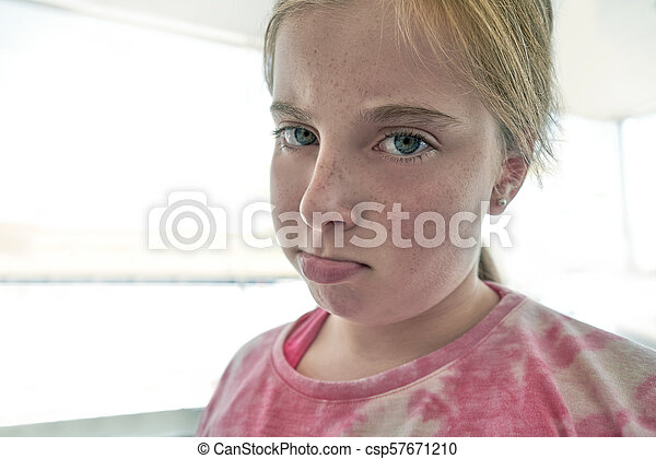 Blond angry lips kid girl expression - csp57671210