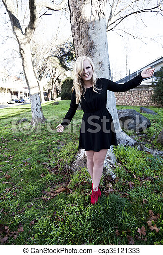 Blond Caucasian Woman Outdoors Black Dress Red Shoes - csp35121333