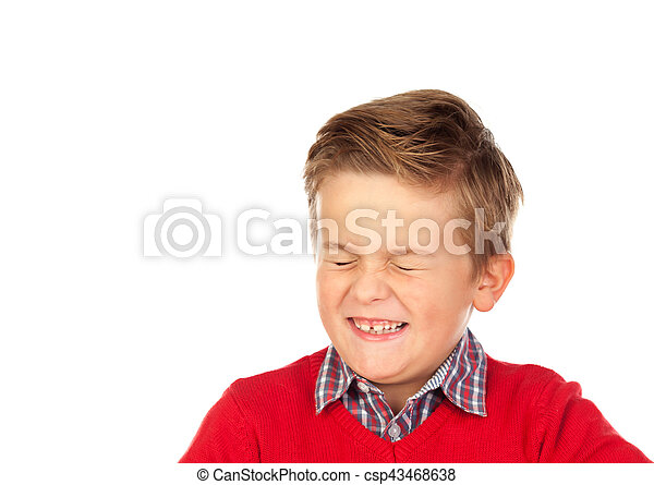 Blond child with a funny expression closing his eyes - csp43468638