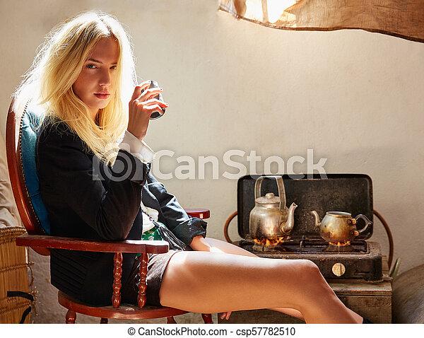 blond fashion girl drinking tea in grunge indoor - csp57782510