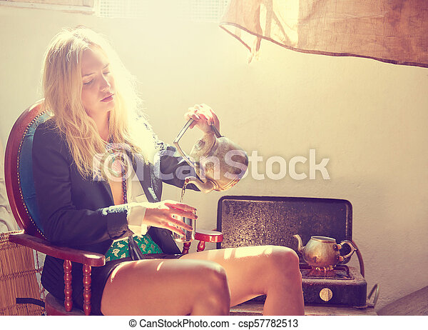 blond fashion girl drinking tea in grunge indoor - csp57782513