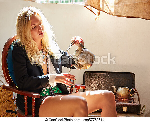 blond fashion girl drinking tea in grunge indoor - csp57782514