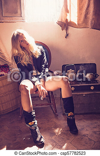 blond fashion girl drinking tea in grunge indoor - csp57782523