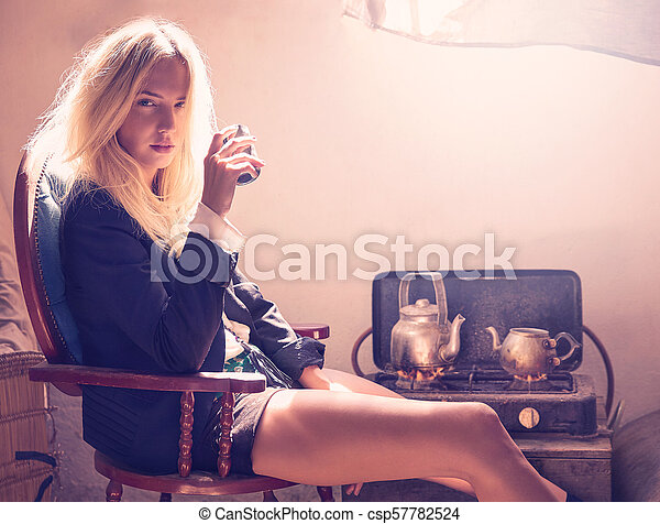 blond fashion girl drinking tea in grunge indoor - csp57782524