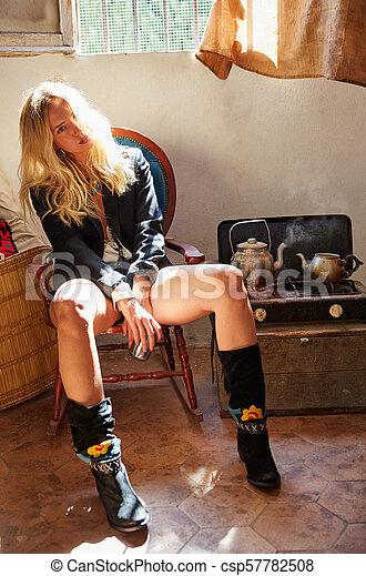 blond fashion girl drinking tea in grunge indoor - csp57782508