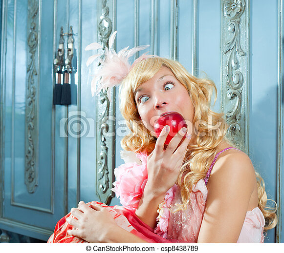 blond fashion princess eating apple funny expression - csp8438789
