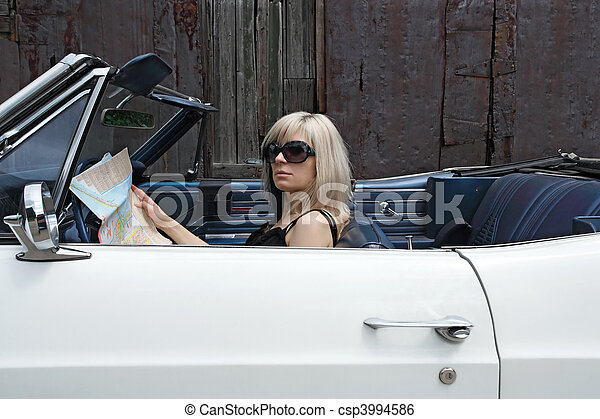 Blond female in convertible car - csp3994586
