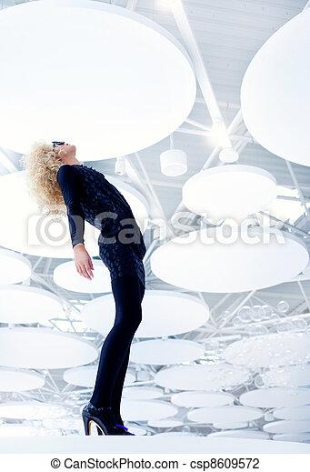 Blond futuristic vintage sexy woman in black - csp8609572