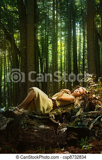 Blond girl in a magic forest - csp8732834