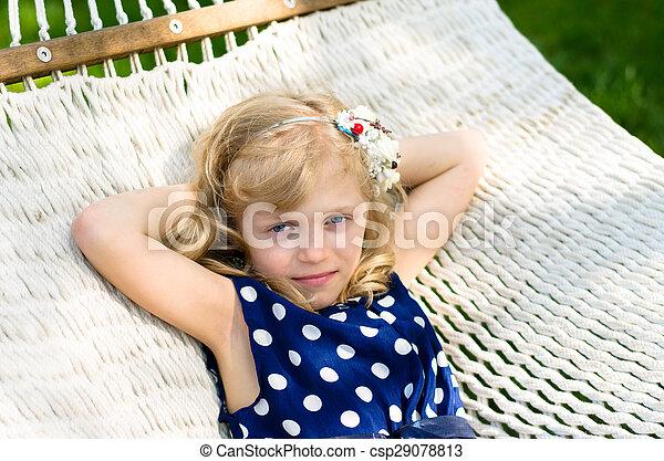 blond girl in hammock - csp29078813