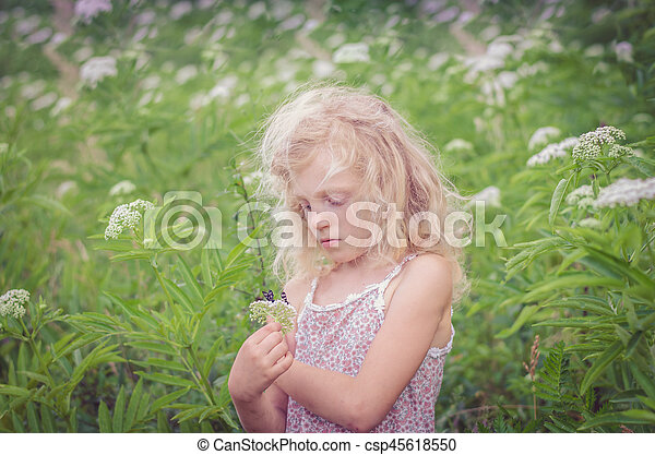blond girl in meadow - csp45618550