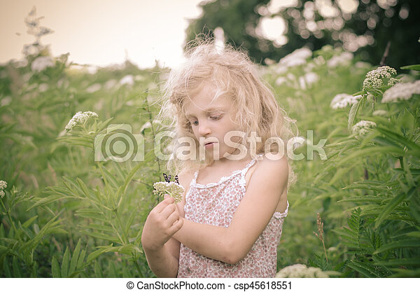 blond girl in meadow - csp45618551