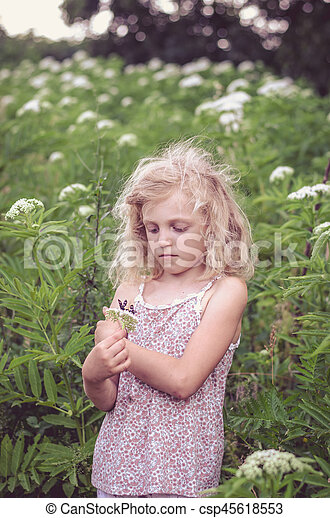 blond girl in meadow - csp45618553