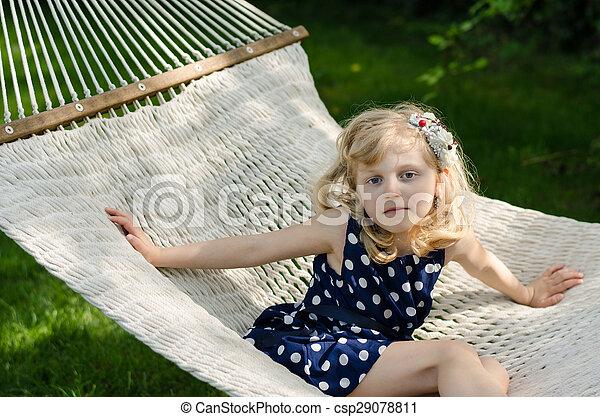 blond girl in white hammock - csp29078811