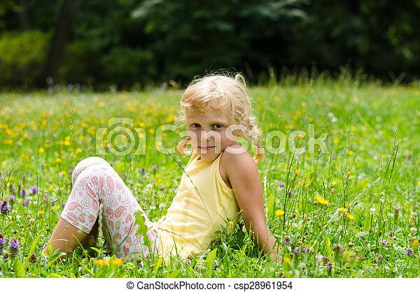blond girl on grass - csp28961954
