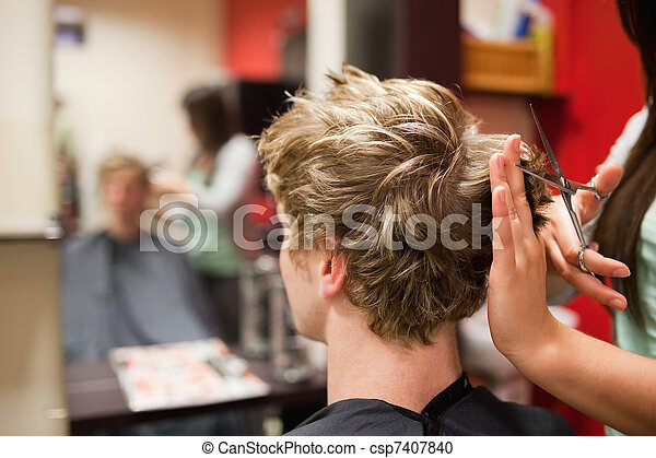 Blond-haired man having a haircut - csp7407840