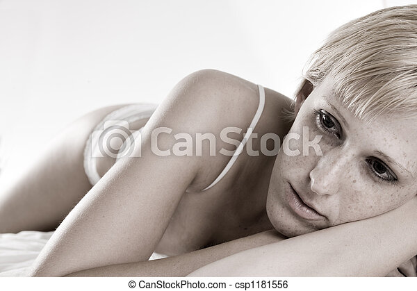 Blond in lingerie laying down bored - csp1181556