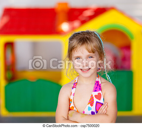 blond kid girl crossed arms in toy house - csp7500020