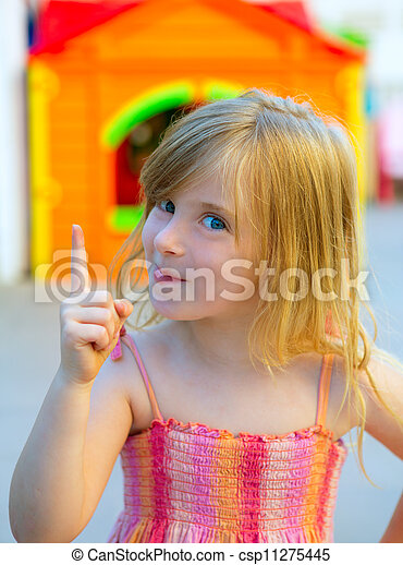 Blond kid girl funny gesture finger up in playground - csp11275445