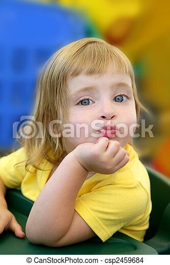Blond little girl funny expression in her mouth - csp2459684
