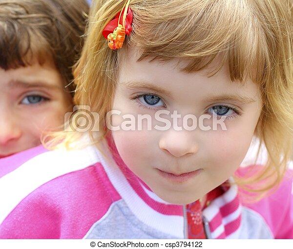 blond little girl portrait funny gesturing face - csp3794122