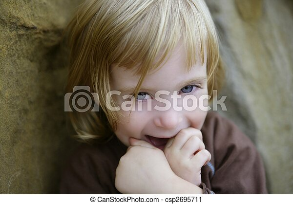 Blond little toddler girl with funny gesture - csp2695711