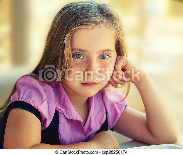 Blond relaxed sad kid girl expression blue eyes - csp28250174