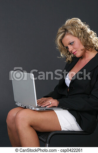 Blond Secretary with notebook on her legs - csp0422261