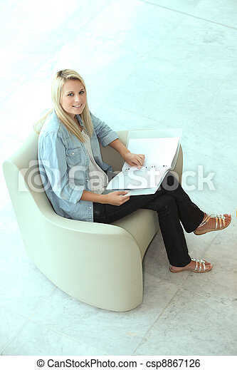 Blond teenager revising - csp8867126