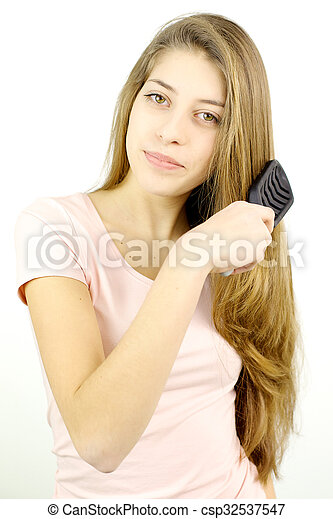Blond Teenager With Very Long Hair Brushing Smiling Looking Camera Csp32537547