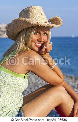 da87242abc75e Blond woman girl wearing cowboy hat on beach. Beautiful blond young ...