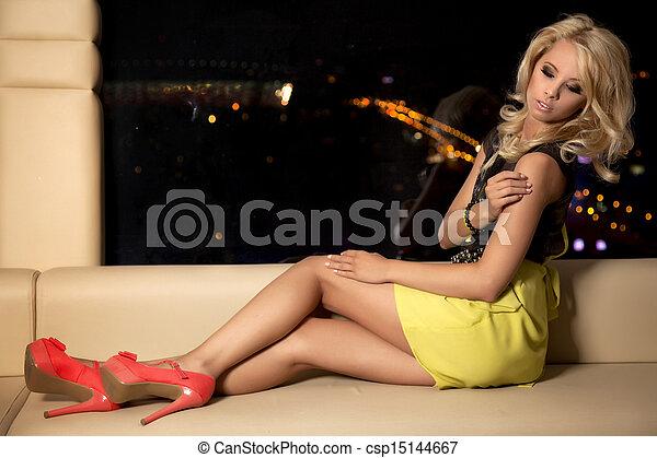 blond woman in black dress - csp15144667
