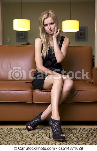 blond woman in black dress - csp14371629