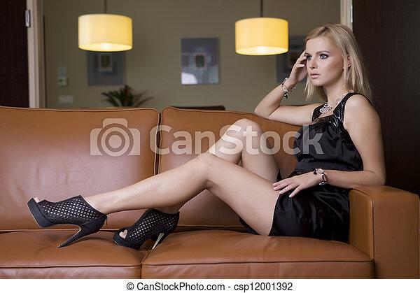 blond woman in black dress - csp12001392