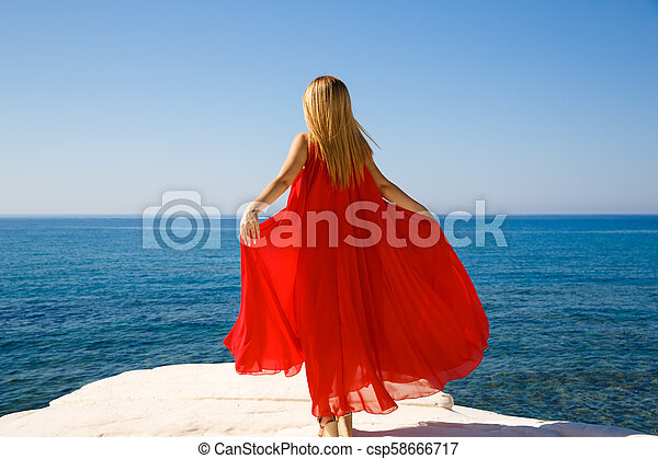 Blond woman in red - csp58666717