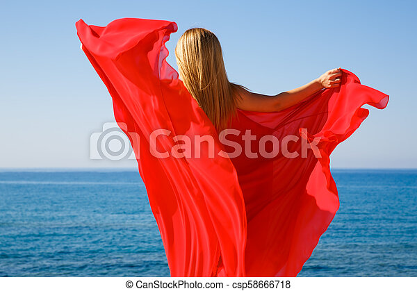Blond woman in red - csp58666718